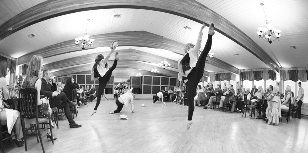 Dancers leap during Spring Fling dinner theater event in Cody, Wyoming