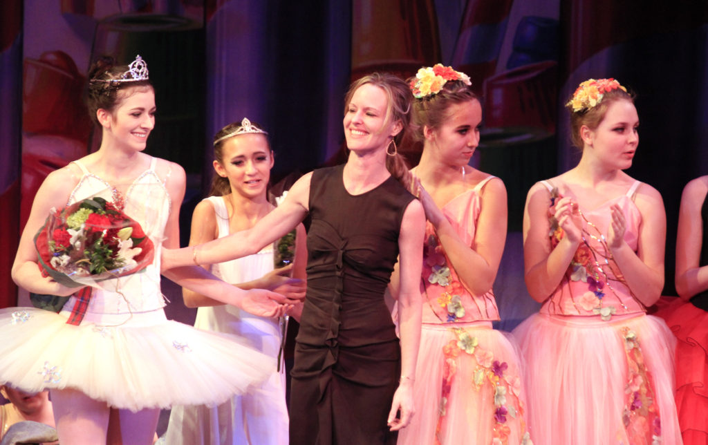 Elizabeth on stage with dancers at end of Nutcracker Production