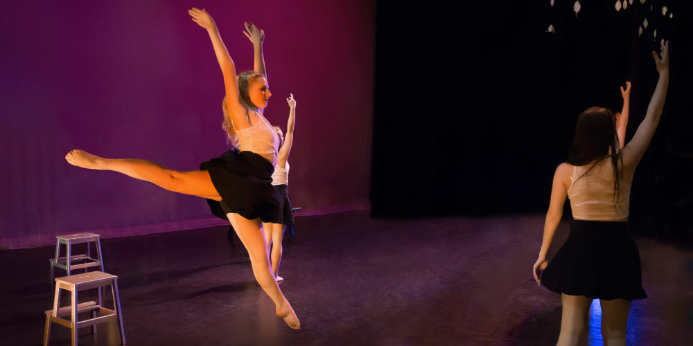 RMDT Dancer leaping on stage.