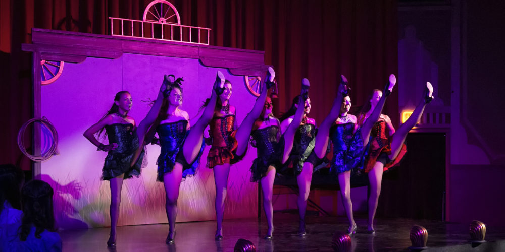 Saloon Girls Can-Can on stage at RMDT's Buffalo Bill's Wild West Show at Cody Theater